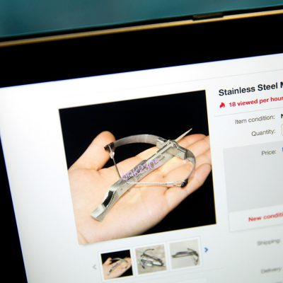 A listing by a Chinese seller on eBay's U.S. site for a miniature crossbow capable of firing toothpicks is seen on a computer screen in Beijing, Friday, June 23, 2017. Powerful mini-crossbows that shoot toothpicks and needles are the new must-have toy for schoolkids across China - and a nightmare for concerned parents and school officials. Several cities have reportedly banned sales of the palm-sized contraptions, which are powerful enough to puncture soda cans, apples and cardboard, depending on the projectile. (AP Photo/Mark Schiefelbein)