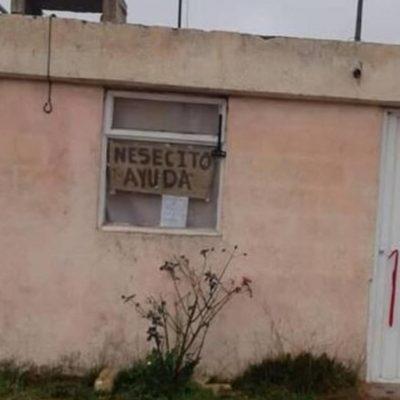 Familia enferma de COVID-19 pide ayuda con letreros en la ventana